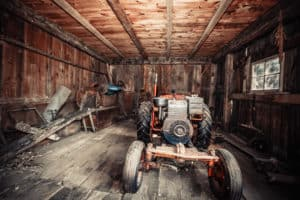 Stonetree Creative - Old tractor in a barn in Maine