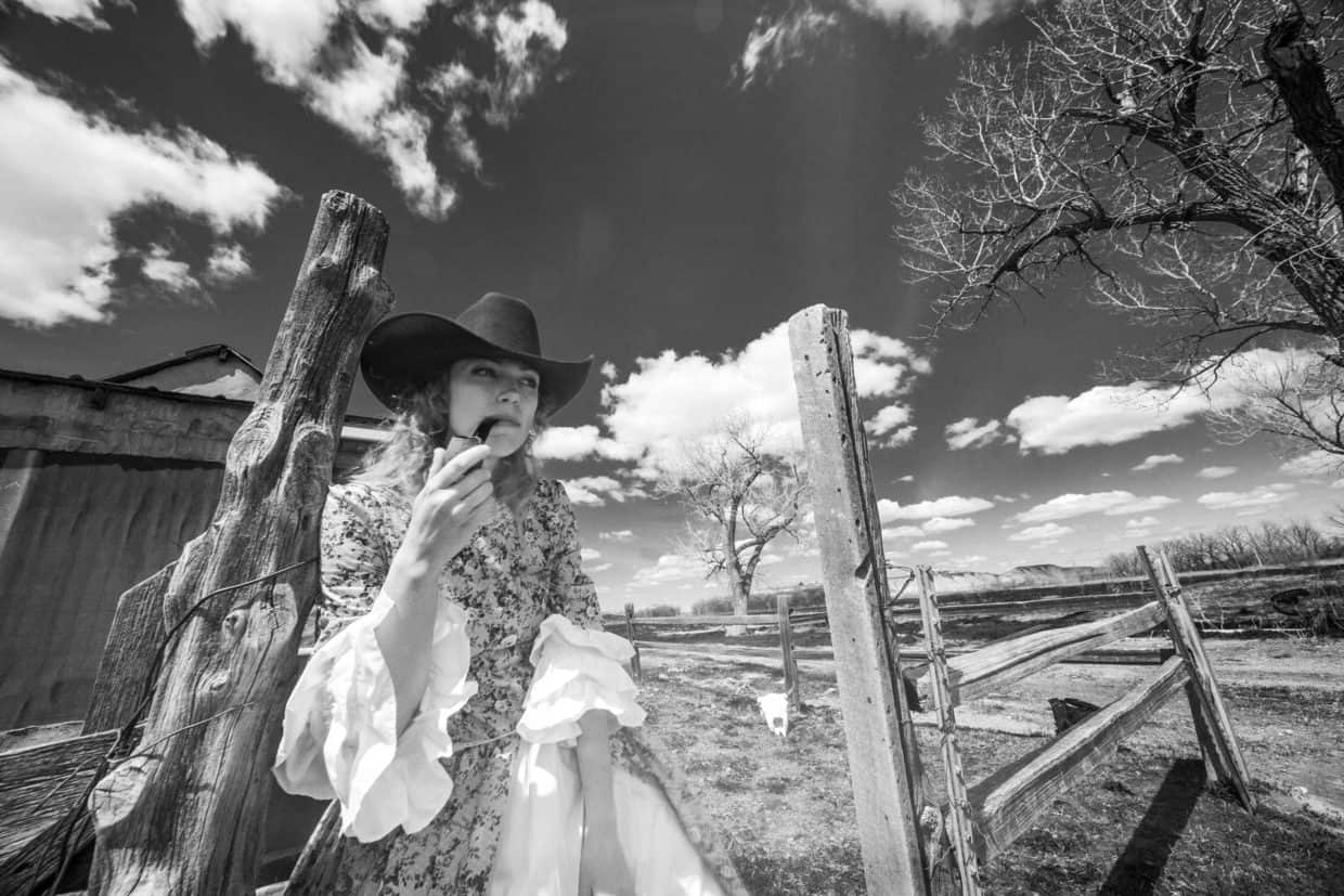 Stonetree Creative - Woman in Old West on a homestead smoking a pipe