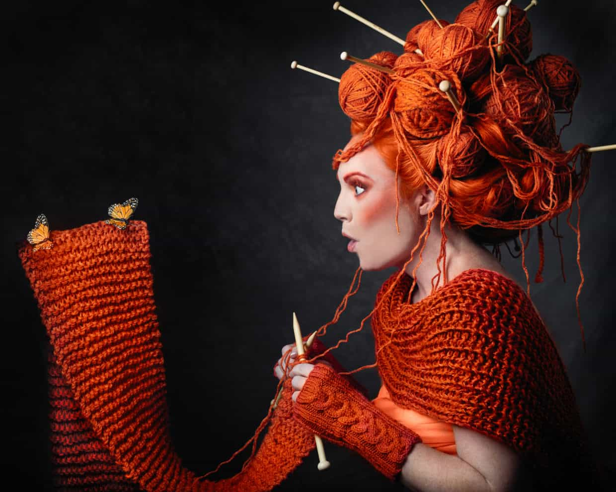 Stonetree Creative - Woman with yarn for hair knitting a scarf