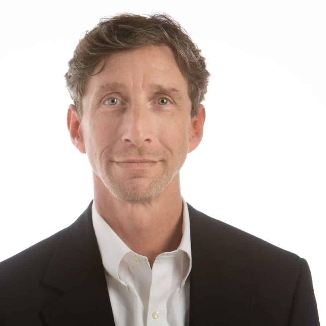 Corporate headshot of man in blazer by Stonetree Creative